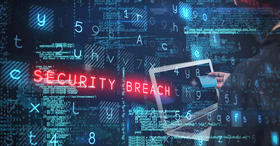 Laptop with code, and 'security breach' text