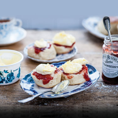 clotted cream and strawberry jam on scones